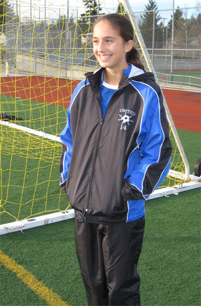 Girl socer player wearing Viper soccer warm up jacket.