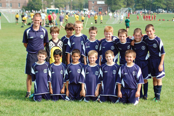 Boys U13 soccer team in Code Four Velocity soccer jerseys and shorts.